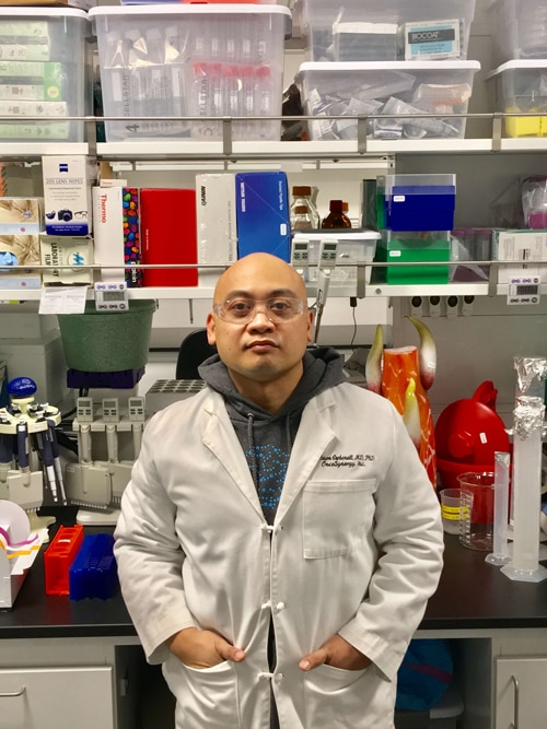 Man standing in lab supply room